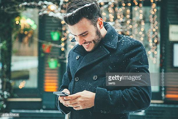 Young man texting message with smartphone