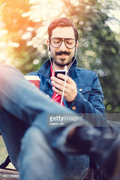 Young man texting on smartphone