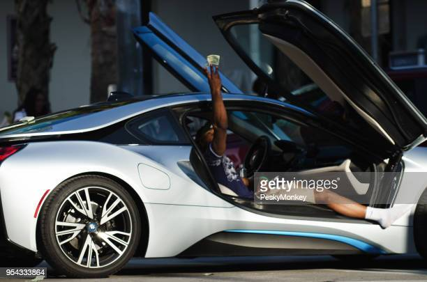 Young Man Throwing Money Ocean Drive in South Beach Miami