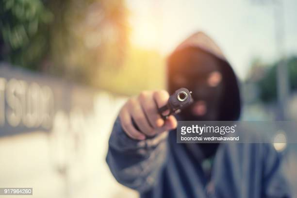 young man took aim with pistol near village roads. - shooting crime stock pictures, royalty-free photos & images