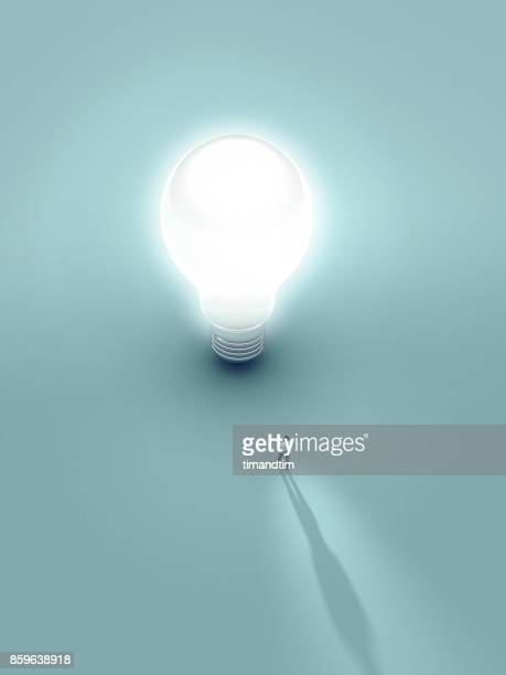 Young man touched by the light from a bulb