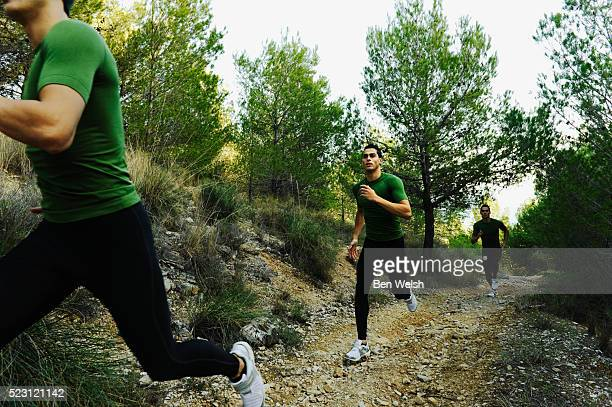 young man trail running - multiple exposure sport stock pictures, royalty-free photos & images