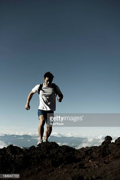 young man training in the mountain,running