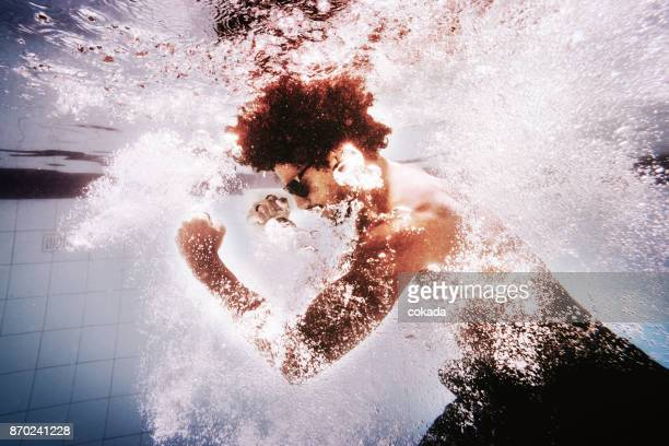 young man training martial arts underwater - mixed boxing stock photos and pictures