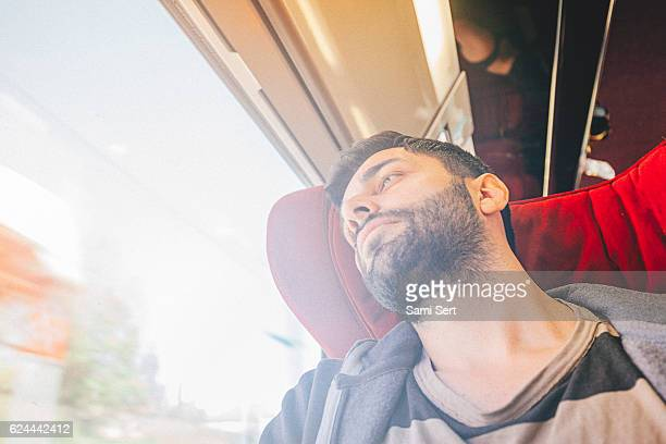 Young Man Traveling In Train - Lost in thought