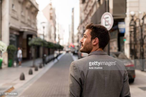 young man traveling through the city - buenos aires stock pictures, royalty-free photos & images