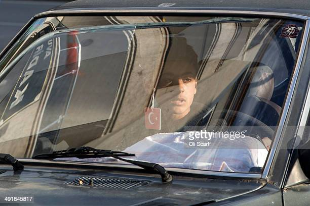 A young man travels in a car through Soma town centre with a air freshener displaying the Turkish national flag on May 17 2014 in Soma Turkey...