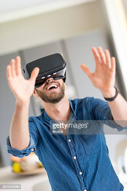 Young man trying virtual reality eyeglasses device