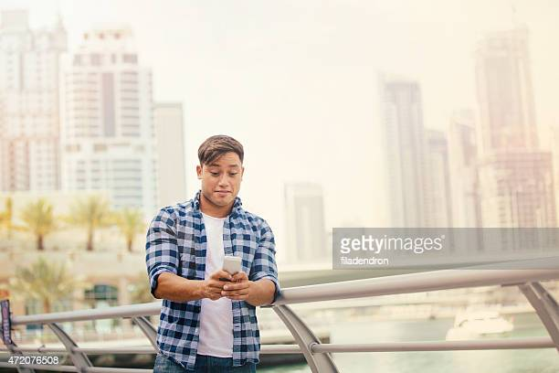 Young man typing text message