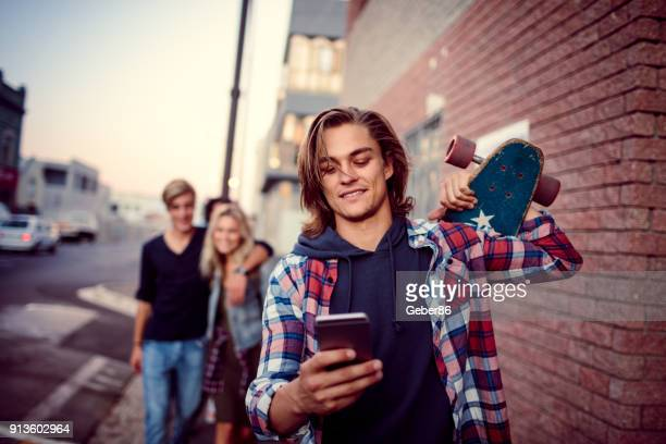 young man using a phone - youth culture stock pictures, royalty-free photos & images