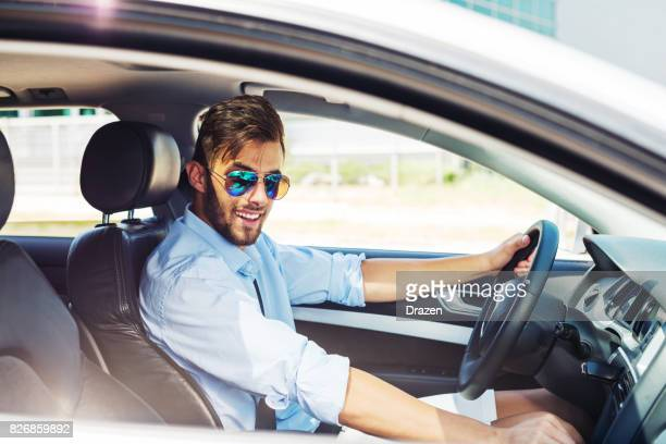 young man using car pooling service - car pooling stock photos and pictures