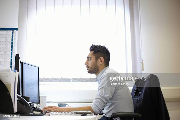 Young man using computer in office
