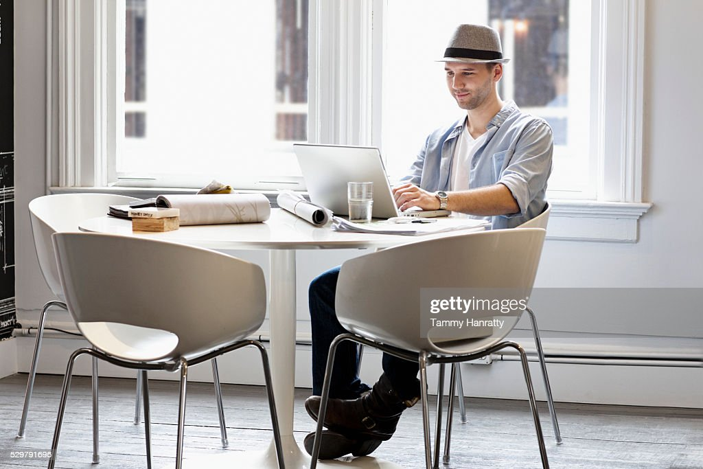 Young man using computer : Bildbanksbilder