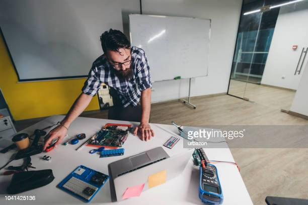 young man using computer while soldering - lap circuit stock pictures, royalty-free photos & images