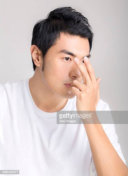 Young Man Using Contact Lenses