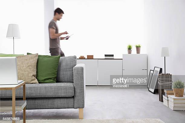Young man using digital tablet in his living room