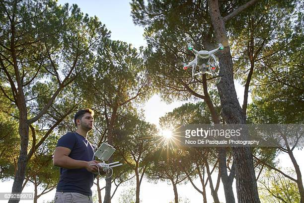 young man using drone - remote controlled stock photos and pictures