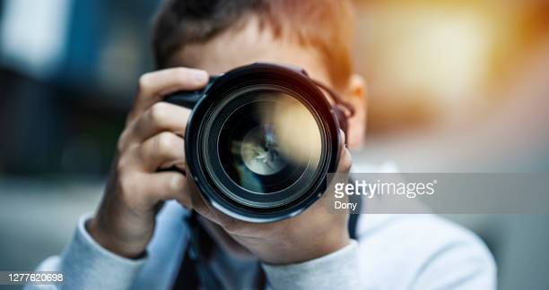 young man using dslr camera - photographer stock pictures, royalty-free photos & images