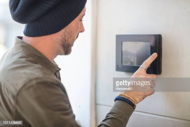 young man using intercom in office - intercom stock pictures, royalty-free photos & images