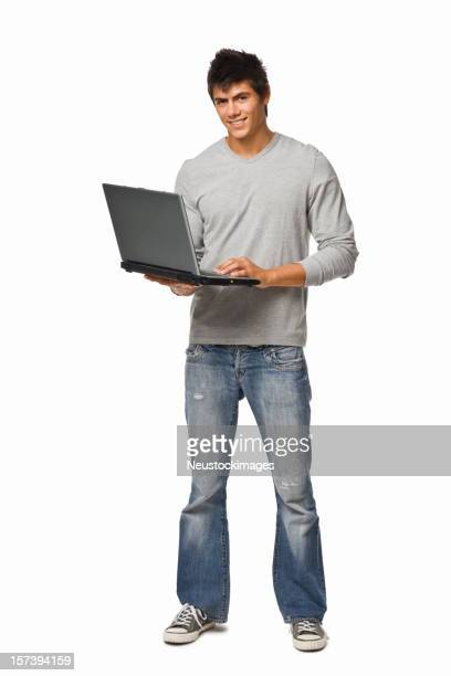 Young man using laptop against isolated white background