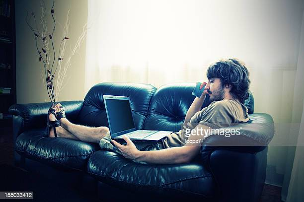 young man using laptop and credit card