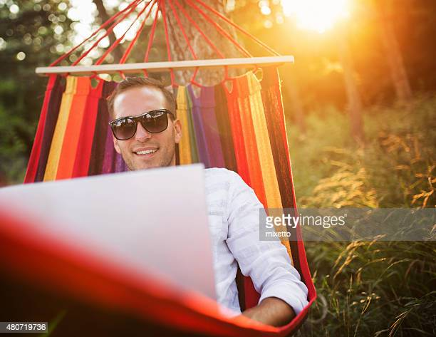 Young man using laptop computer on vacation