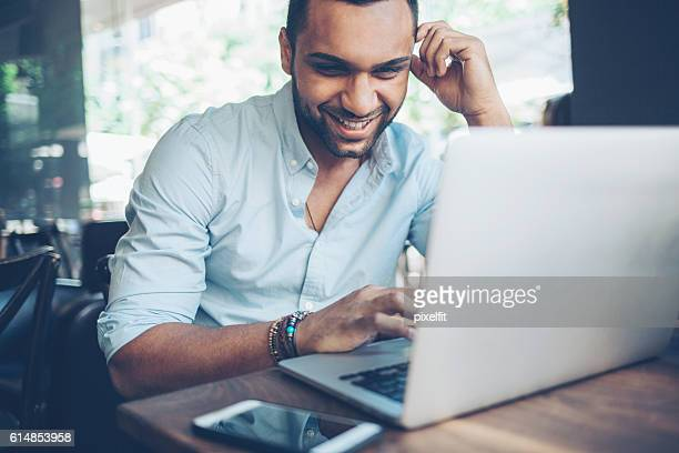 young man using laptop - online class stock pictures, royalty-free photos & images