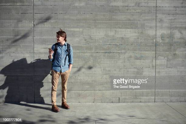 young man using mobile phone for directions - lost stock pictures, royalty-free photos & images