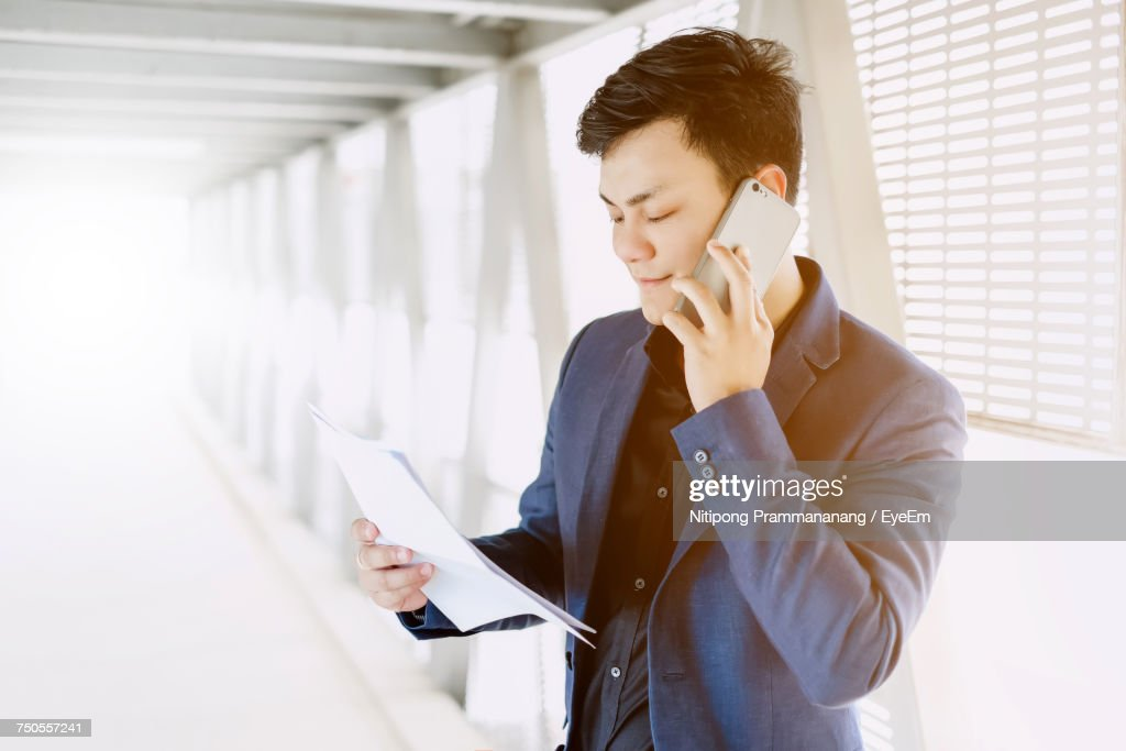 Young Man Using Mobile Phone : Stock Photo