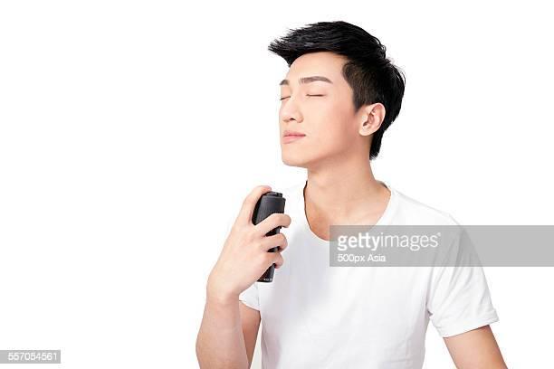 Young Man Using Perfume
