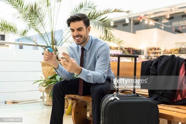 Young man using smart phone and credit card
