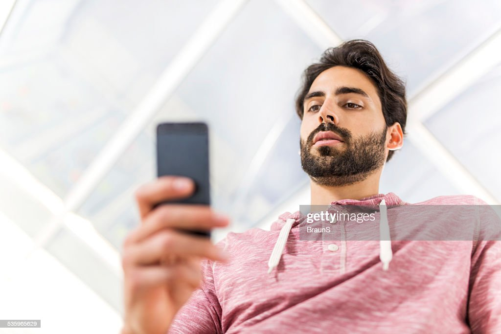 Young man using smart phone. : Stock Photo