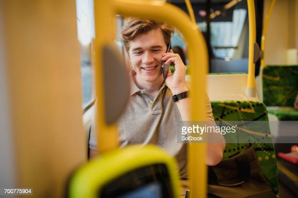 Young Man Using Smartphone on the Tram