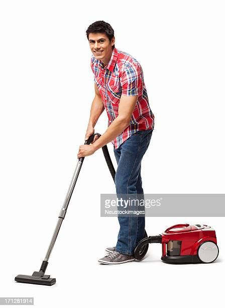 Young Man Using Vacuum Cleaner - Isolated