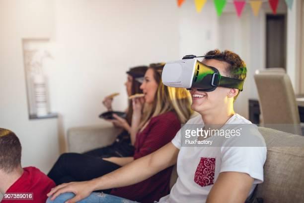Young man using virtual reality simulator