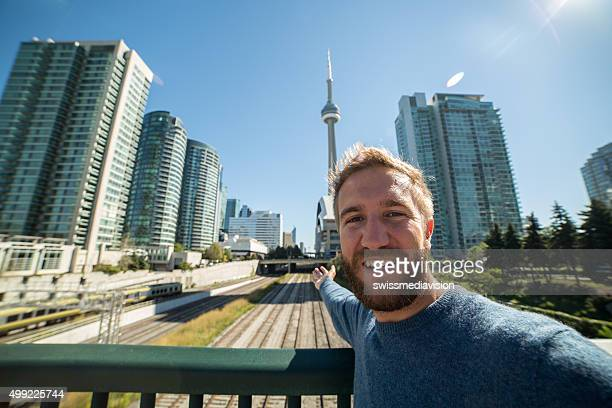 Young man visiting Toronto takes selfie portrait