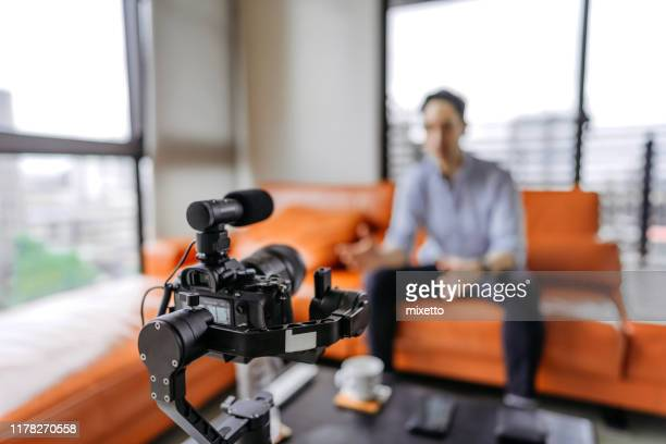 young man vlogging about his business life - presenter stock pictures, royalty-free photos & images