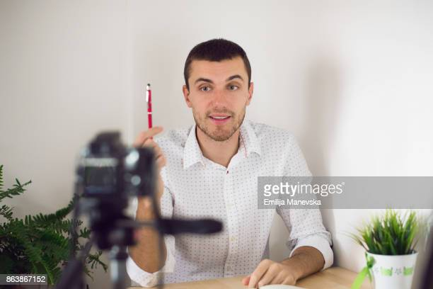 young man vlogging - pointing at camera stock photos and pictures