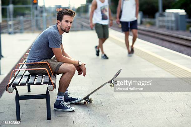 Young man waiting at train station