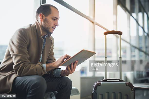 Young man waiting for flight