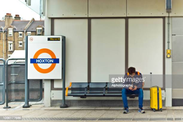 A young man waiting for the train
