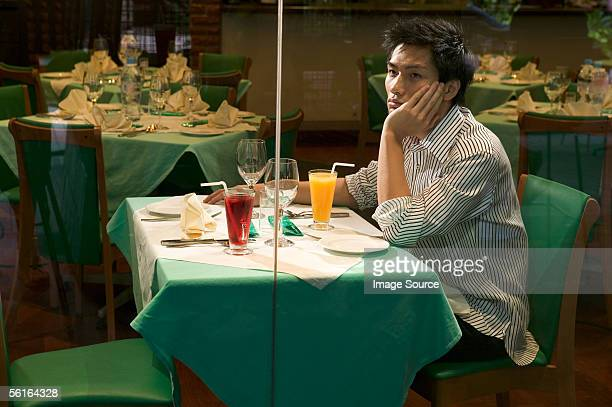 Young man waiting in restaurant