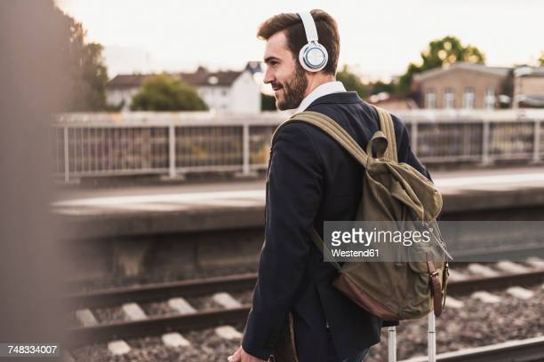 Young man waiting on platform
