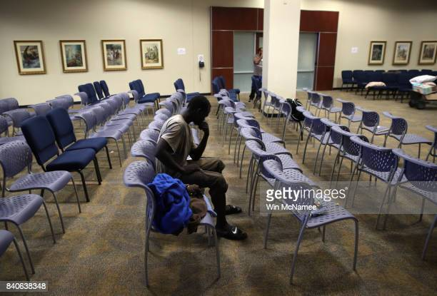 A young man waits to be processed into the temporary shelter located at the Lakewood Church August 29 2017 in Houston Texas Thousands of Houston area...