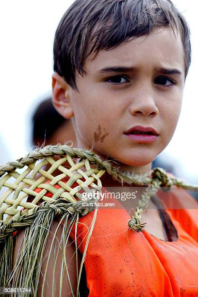A young man waits to board his Waka on February 6 2016 in Waitangi New Zealand The Waitangi Day national holiday celebrates the signing of the treaty...