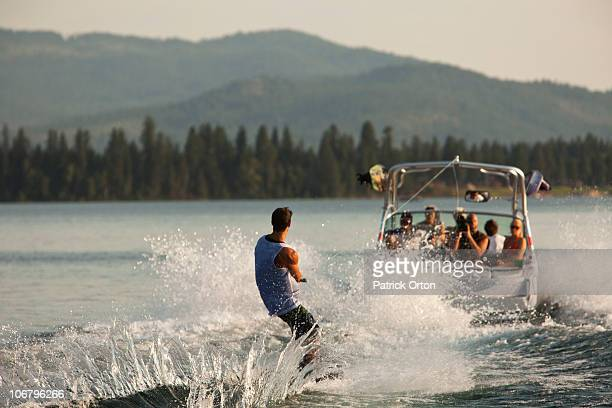 young man wakeboarding in idaho. - waterskiing stock photos and pictures