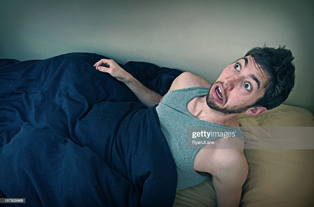 Young Man Wakes Up From Bad Dream : Stock Photo
