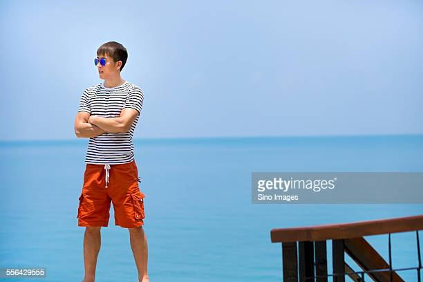 Young Man Walking at Seaside