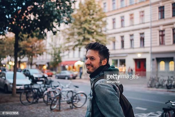 young man walking in berlin prenzlauer berg - prenzlauer berg stock photos and pictures