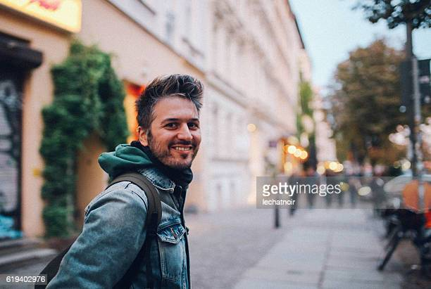 Young man walking in Berlin Prenzlauer Berg